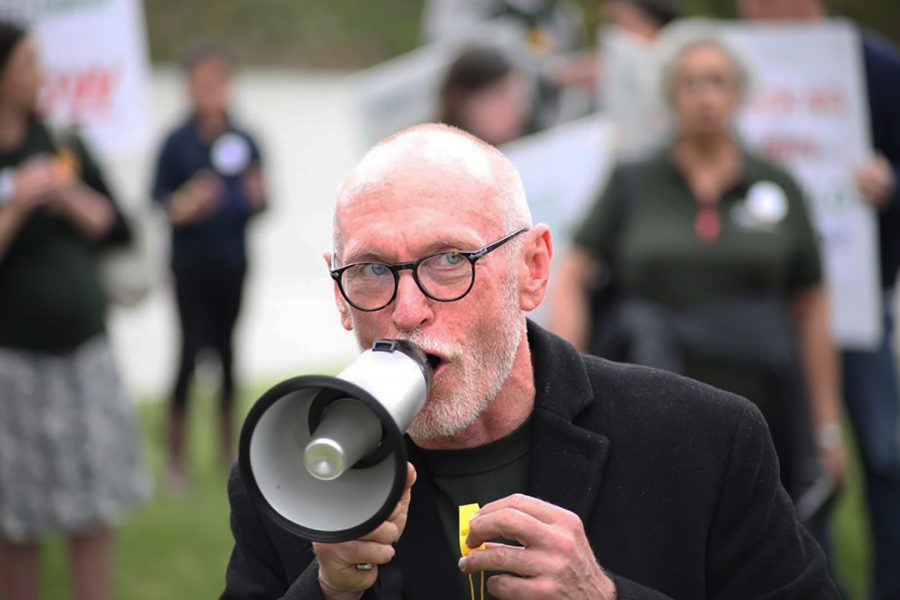 Gary Enke leads a march on the lawn of the Founder's Hall in front of Mt. SAC in Walnut, California on May 8, 2019. Mt. SAC Staff and Faculty had been protesting to prevent the change in healtcare plans with Enke and others leading protests to keep their health care plans. Photo credit: Abraham Navarro/SAC.Media.