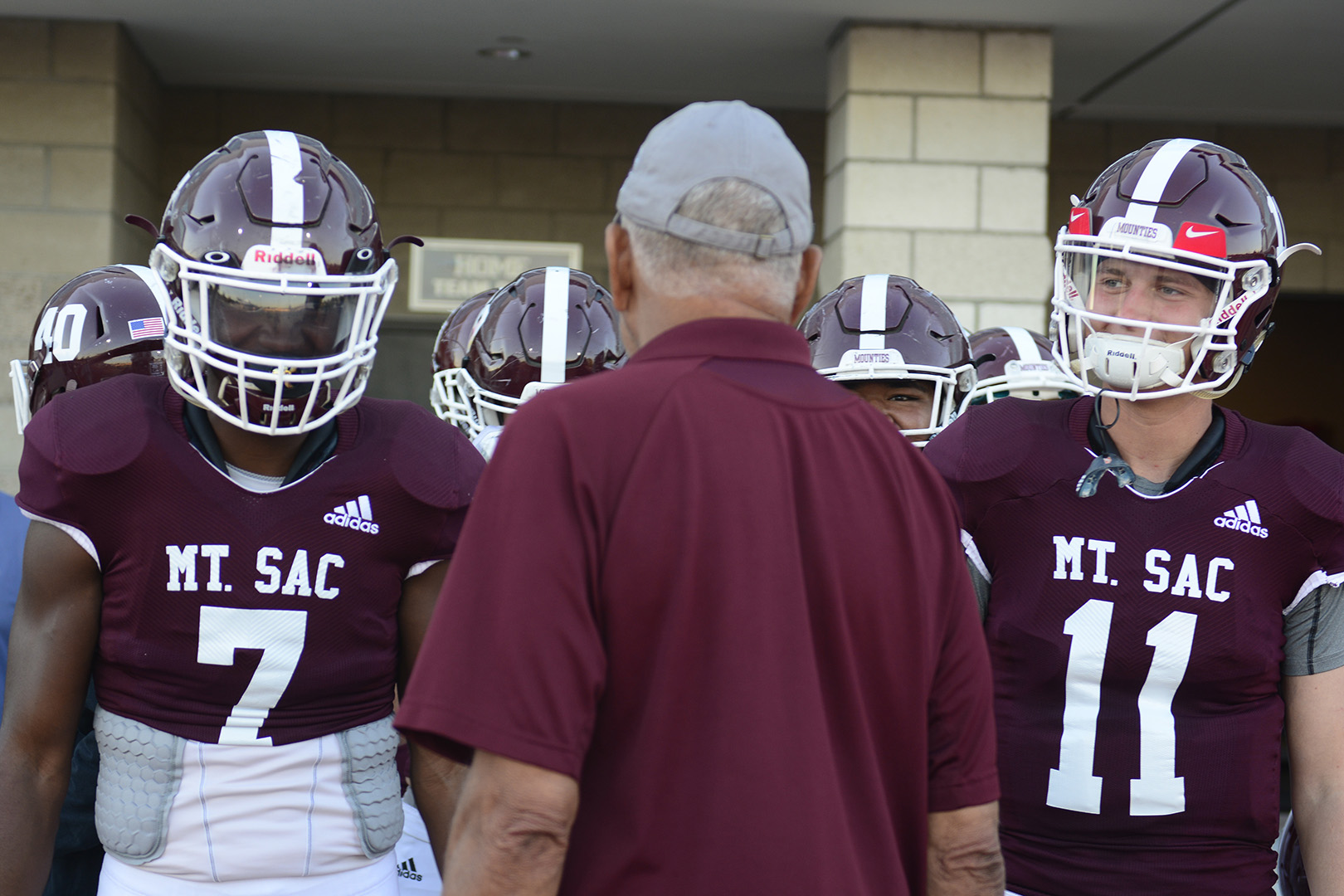 Running back Rachaad White(left) and quarterback Zachary Rangel speak with Assistant Coach Evans Roderick before Mt. SAC Football game against Palomar College. Photo credit: Mychal Corbin/SAC.Media