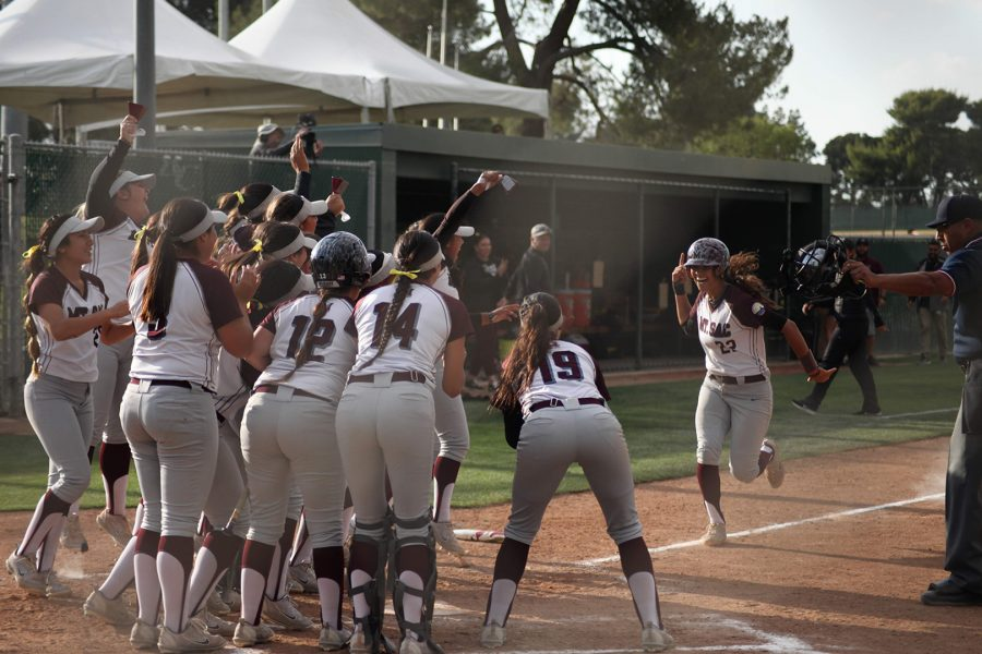 Mountie+softball+team+cheer+for+Quinn+De+Avila%2C+player+22%2C+as+she+runs+to+home+base+during+State+Championships+at+the+Dean+and+Adah+Gay+Sports+Complex+at+Bakersfield+College+on+May+17%2C+2019.+Photo+Credit%3A+Abraham+Navarro%2FSAC.Media.