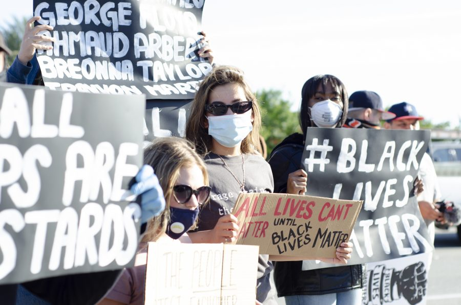 Protesters armed with signs and face masks stand in solidarity over the murder of George Floyd in Rancho Cucamonga, CA, on May 29, 2020. Photo Credit: Brett Hernandez, @hernandezcoke_photo_film on Instagram.