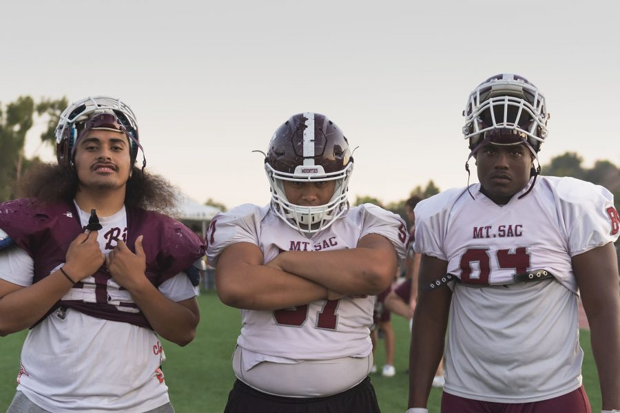 Defensive lineman Joshua Titialii, offensive lineman Jeremiah Titialii, and tight end Evan Richardson after practice at the turf field at Mt. San Antonio College. Photo by Mychal Corbin/SAC.Media