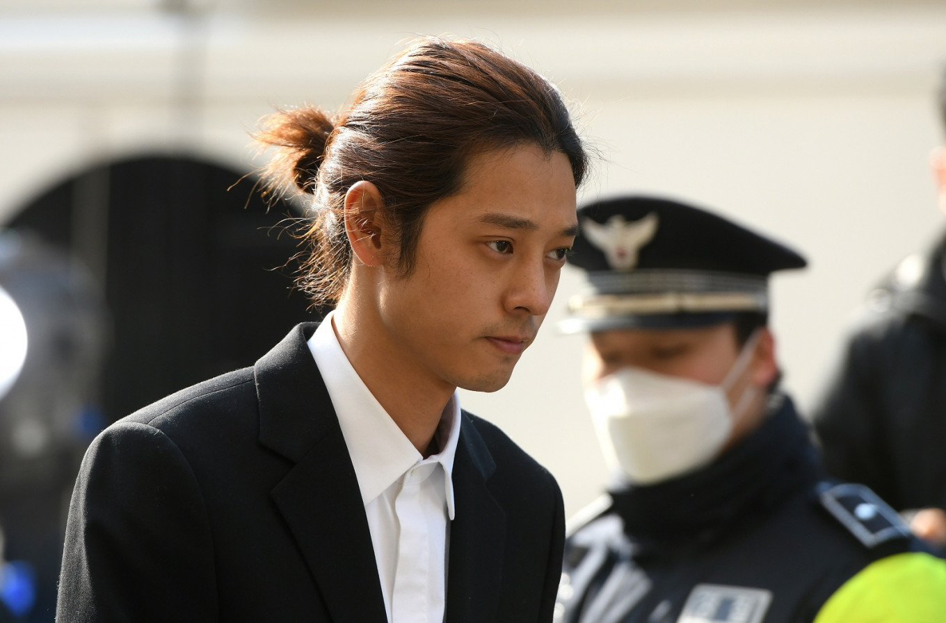K-pop star Jung Joon-young (C) arrives for questioning in Seoul