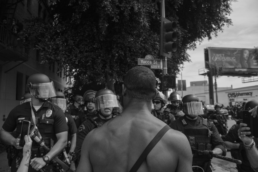 Protests erupted throughout the region  when Los Angeles Police Department officers in military gear push back on demonstrators on June 1, 2020 in Hollywood, California. Photo by Pablo Unzueta.