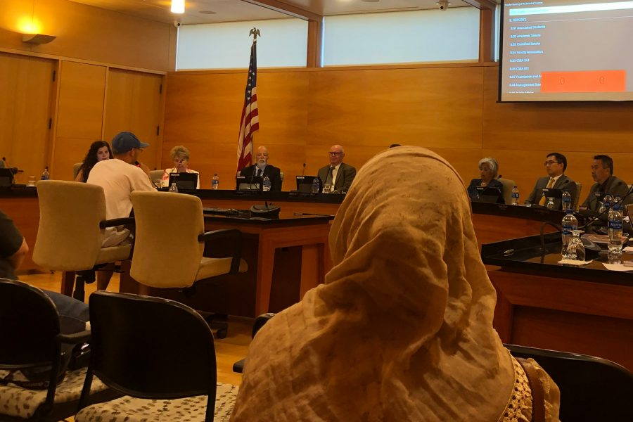 Amani+Mubarak+sits+in+on+the+July+10+Board+of+Trustees+meeting%2C+while+another+individual+speaks+on+her+behalf.+Photo+credit%3A+Berenize+Montoya%2FSAC.Media.