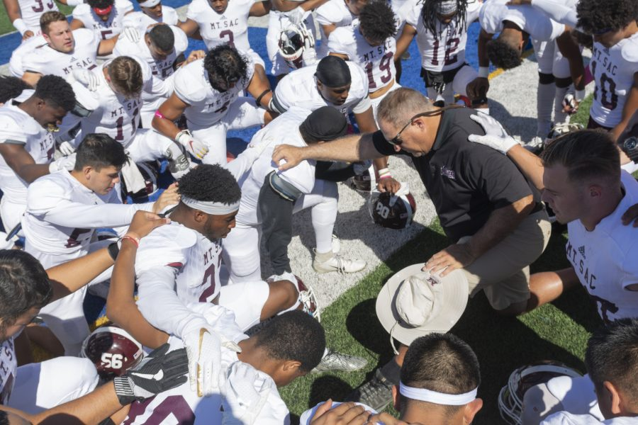 The Mt. SAC football team gathers for a prayer before a game. Photo by Mychal Corbin/SAC.Media.