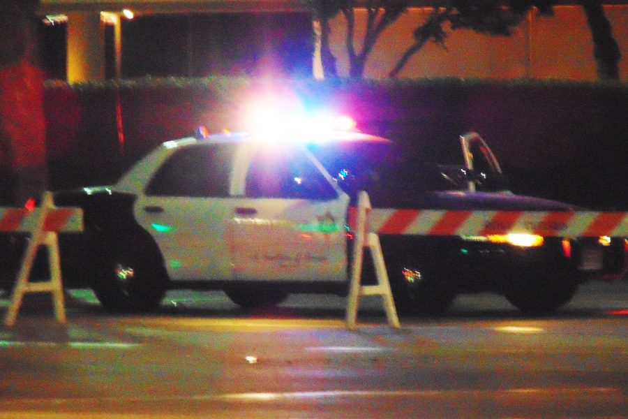 The scene and West Pomona Boulevard are barricaded while the crime is investigated. Photo Credit: Joshua Sanchez.