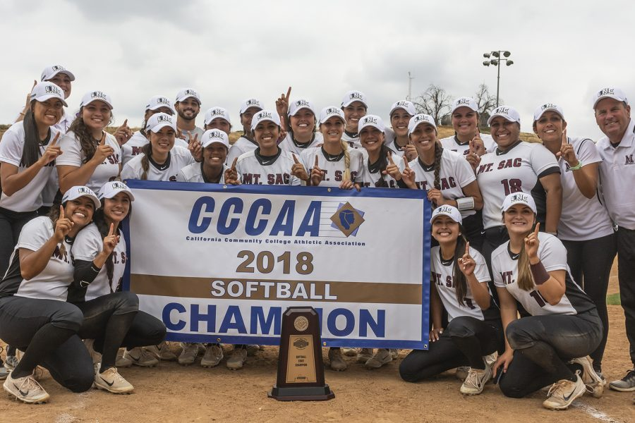 Mt. SAC Softball with the 2018 CCCAA State Championship banner and trophy on Sunday, May 20. Photo Credit: Mychal Corbin @shotstotheheart