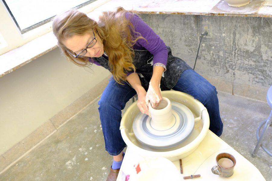 Cj Jilek, ceramic artist and professor, begins work on a bowl in the Mt. SAC ceramics classroom. Photo Credit: Doug de Wet/SAC.Media