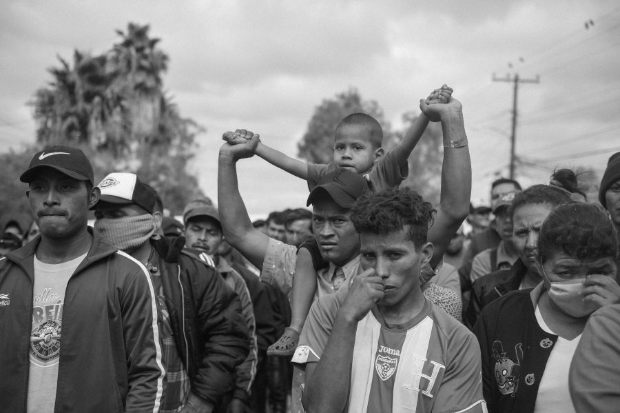 Central+American+migrants+and+asylum+seekers+gather+for+an+impromptu+church+service+outside+the+Benito+Juarez+sports+complex+in+Tijuana%2C+Mexico%2C+on+Nov.+28%2C+2018.+Photo%3A+Pablo+Unzueta