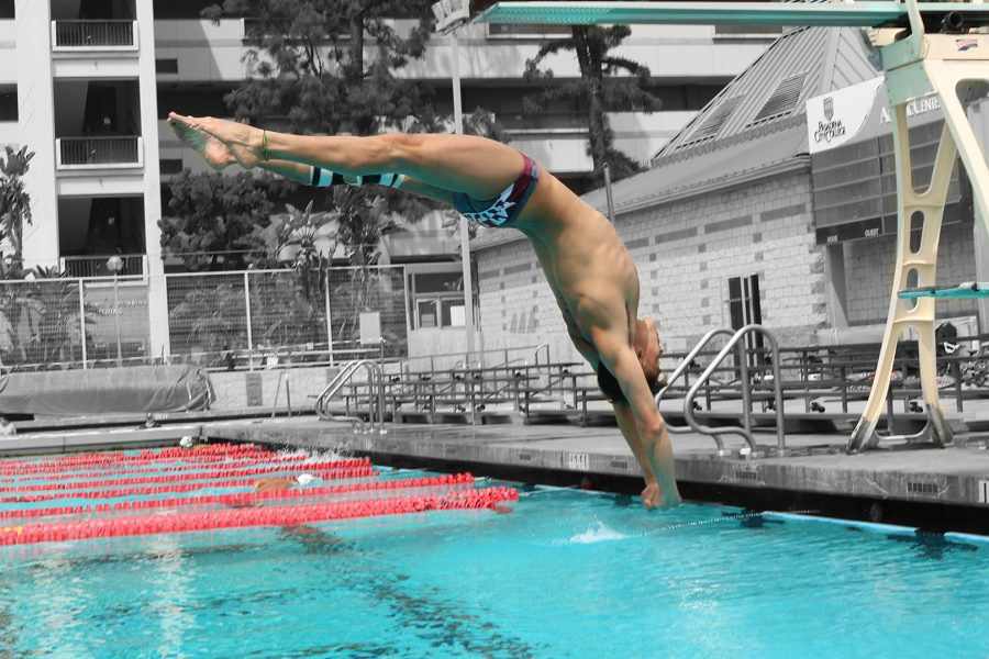 Andres+Jaramillo+performs+a+303C+reverse+1.5+dive+tucked+on+the+one+meter+board+at+the+Pasadena+City+College+Diving+Invitational+on+April+5.+Photo+Credit%3A+Melody+Waintal