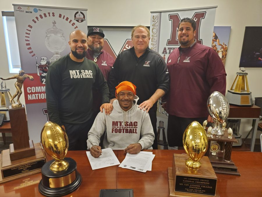Jontavis Walker poses for a photo with Mt. SAC football coaches (left to right): Wide receiver coach Micheal Edwards, offensive coordinator Robert Purcell Jr., offensive line Phil Ramirez. Photo: Brigette Lugo/SAC Sidelines