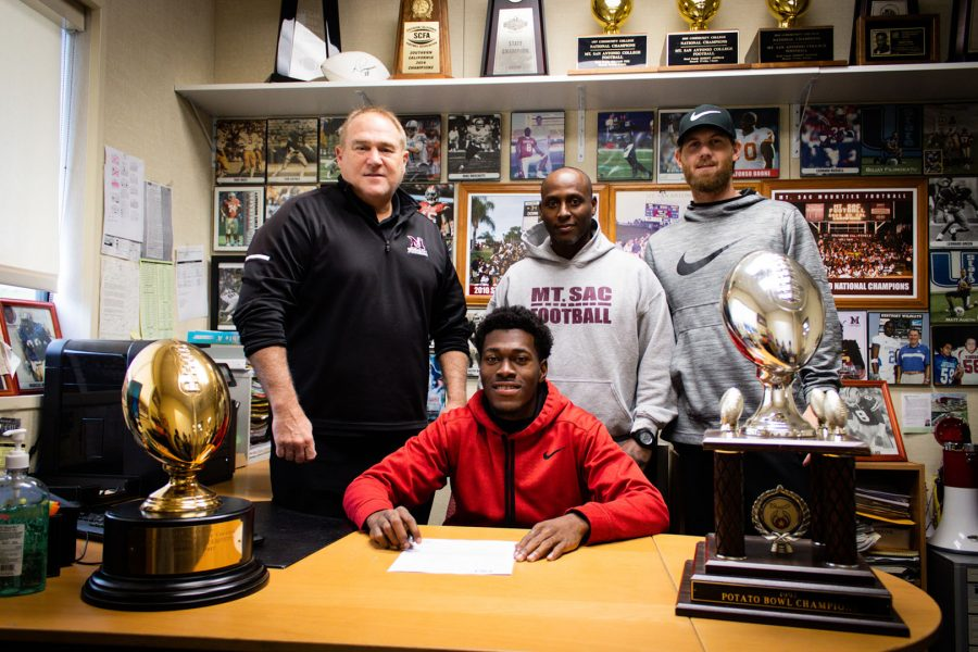 Mt. SAC Football Defensive Back Levon Barnett poses with head coach Bob Jastrab, defensive coordinator Isaac Carter, and quarterbacks coach/recruiting coordinator Cameron Deen during early signing period on December 18, 2019. Photo by Andrew Talavera/SAC.Media