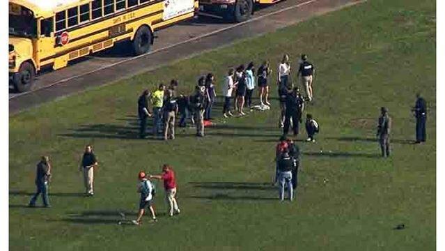Students of Santa Fe High School evacuating campus after a school shooting. Photo Credit: WKRN