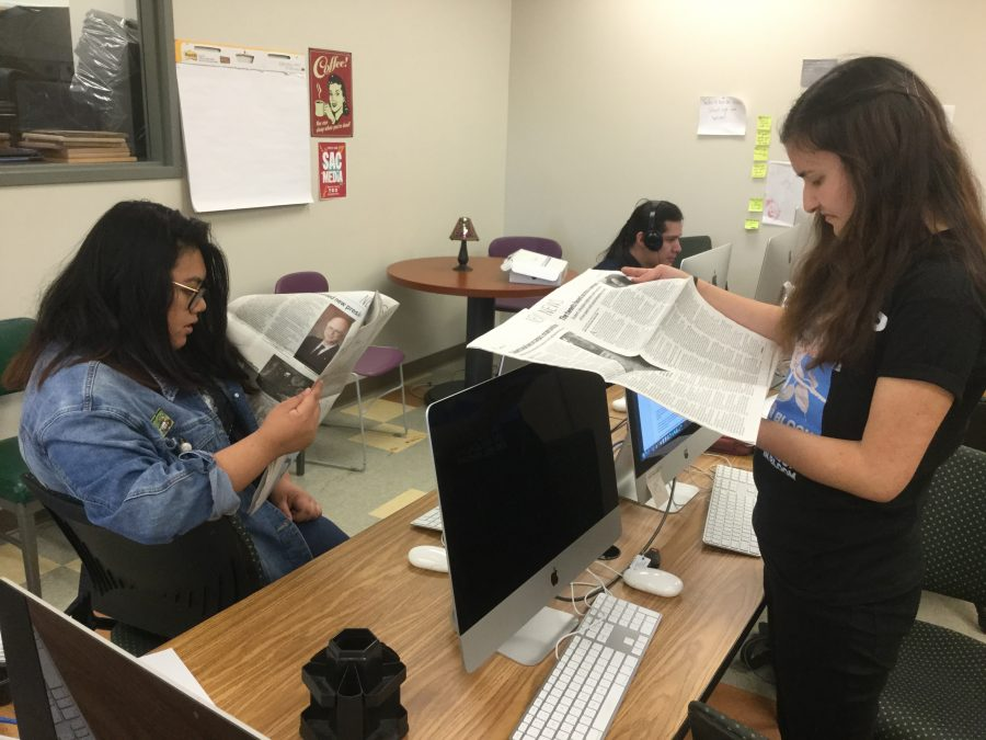 Angelica Cruz and Joliana Frausto look through the print newspapers The Mountaineer in Mt SAC's Student Newsroom. Photo Credit: Melody Waintal/SAC.Media