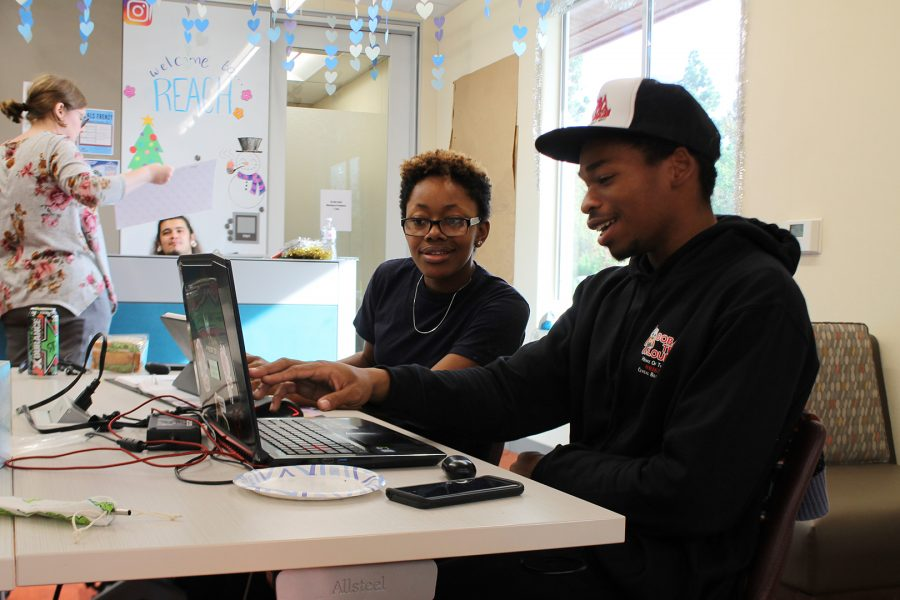 ASPIRE students Aaron Davis and Brianna De'Lynn sit in front of the ASPIRE front desk in the Mt. SAC Equity center. Photo credit: Destany Anderson/SAC.Media.