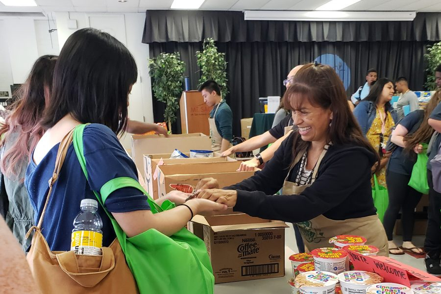 An ISP student worker hands out food at the Mountie Fresh Food Pantry on Sept. 10, 2019. Photo credit: Emerald Fimbres/SAC.Media.