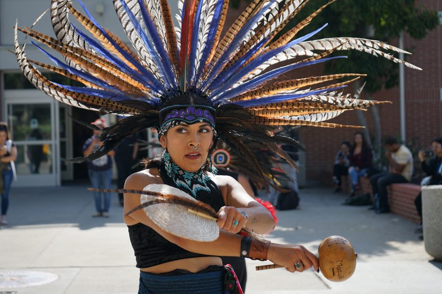 Mt. SAC student and dancer Suzie Kueffner dances a traditional Danza Azteca in front of the Mt. SAC Library on Oct. 14, 2019. Photo credit: Abraham Navarro/SAC.Media.