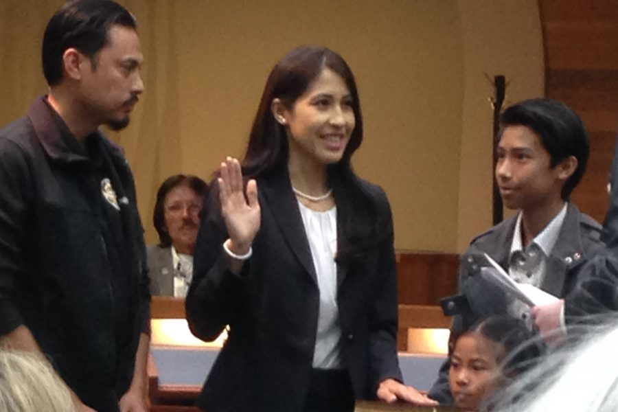 Council+member+Letty+Lopez+takes+the+oath+of+office+beside+her+family.