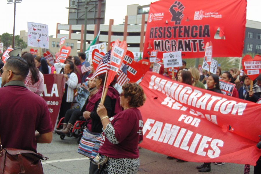 Marchers+for+immigration+reform+hold+signs+while+chanting+in+Spanish+on+May+Day.+Photo+Credit%3A+Joshua+Sanchez%2FSAC.Media%0A