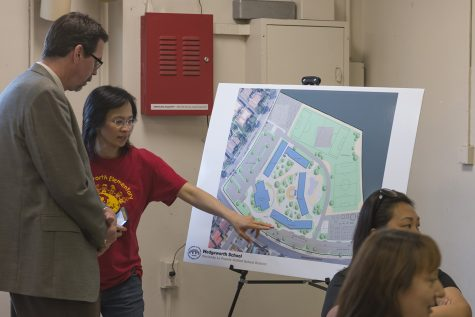 A concerned parent discusses future school plans with architect Marco Eacrett. Photo Credit: Mychal Corbin/SAC.Media.