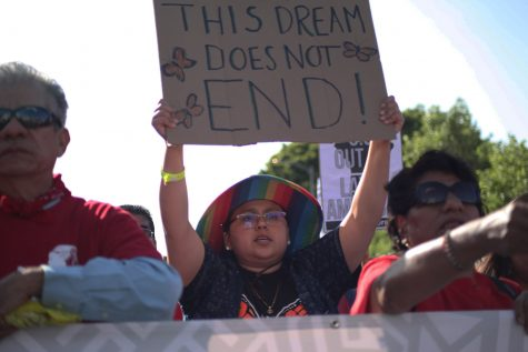 "Student Geovanna Costillo held a sign that said, ""This Dream Does Not End!"" at the head of the May Day March. Photo Credit: Abraham Navarro/SAC.Media."