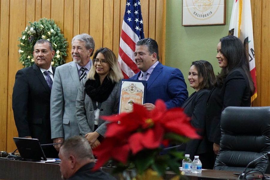 Outgoing+La+Puente+council+member%2C+David+Argudo%2C+receives+an+award+from+Andrea+Moreno%2C+a+representative+from+Hilda+Solis%27+office.