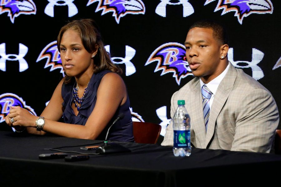 NFL player for the Baltimore Ravens, Ray Rice, with then fiance and now wife, Janay Palmer, at a press conference where Rice addressed the video tape of him hitting and dragging Palmer in an elevator. Photo from Urban Politico.