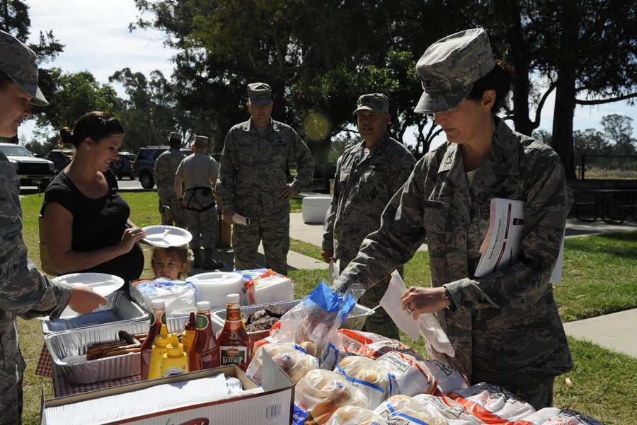 VANDENBERG AIR FORCE BASE, Calif. -- Col. Nina Armagno, 30th Space Wing commander, grabs some lunch at the Combined Federal Campaign Kickoff Barbecue at Cocheo Park here Thursday, Oct. 4, 2012. (U.S. Air Force photo/Staff Sgt. Levi Riendeau)