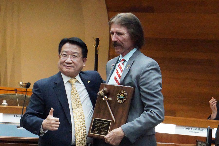 Mew Mayor Tony Wu presents former West Covina Mayor Lloyd Johnson a plaque for his time as mayor on Nov. 19, 2019. Photo credit: Joshua Sanchez/SAC.Media.