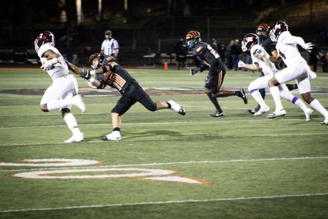 Rachaad White eludes a tackler from Riverside Community College during his last game for Mt. SAC at at Riverside City College