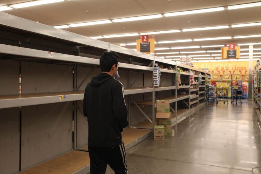 Shelves can be seen out of stock at a Food 4 Less in West Covina, CA amid COVID-19 panic buying. Photo credit: Abraham Navarro/SAC.Media.