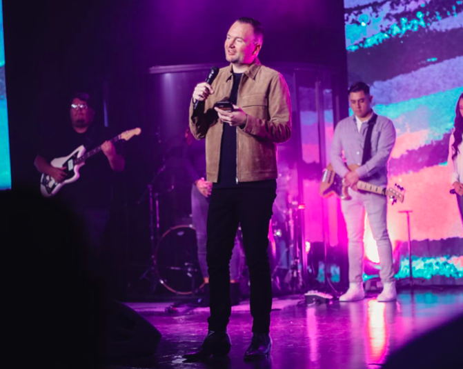 HopeUC Pastor Robert Spina pictured on stage at the Los Angeles location during a Sunday worship service /HopeUC Facebook page.