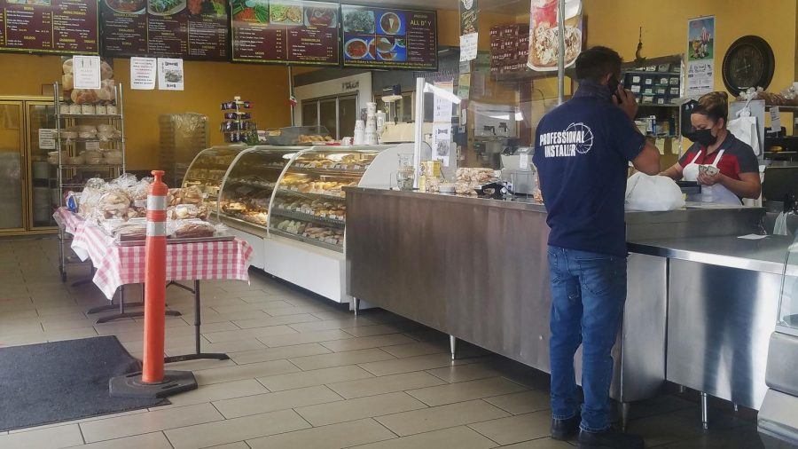 Cashier helps customer at the La Puente Bakery