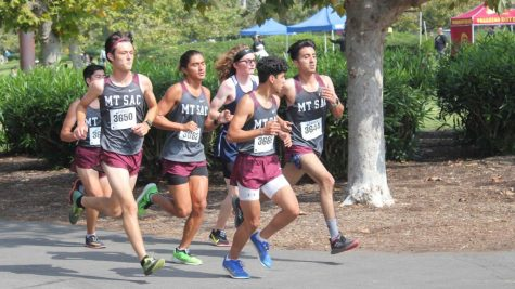 Louis Torres, Kurt Kaihara and Andrew Jagielski join with other Mounties to maintain a steady pace and group morale at the Golden West Invitational on Sept. 24.