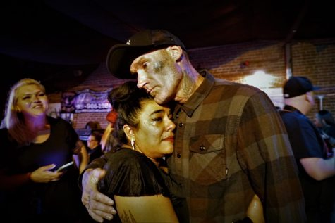 Family and friends grieve during Anthony Ray Riveras memorial at Characters Sports Bar on Sept. 4.