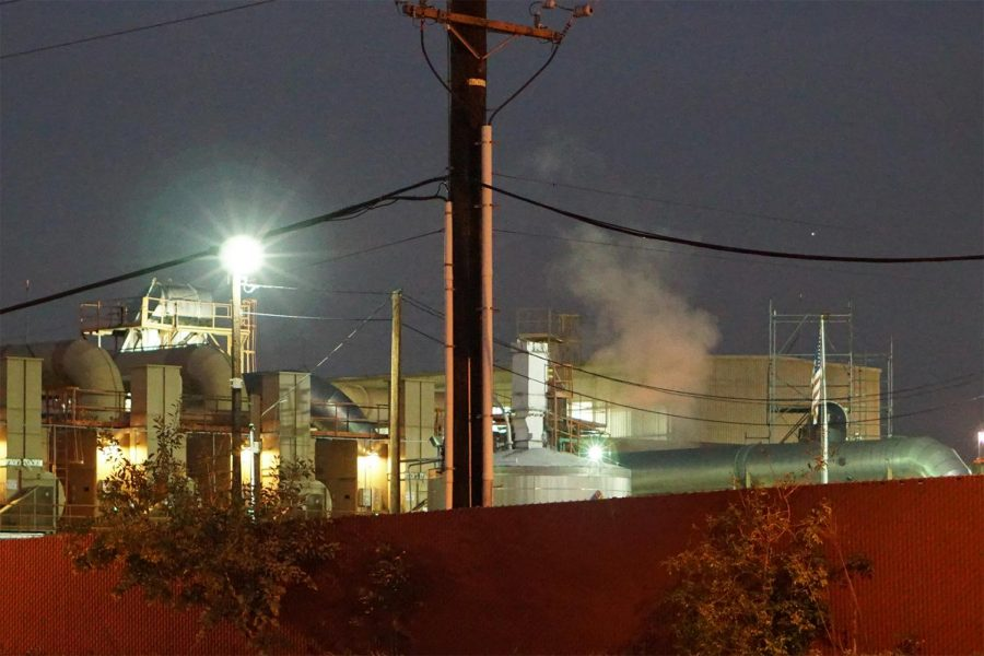 Smoke billows from the west side of the Quemetco facility in the evening hours on Dec. 26, 2018.