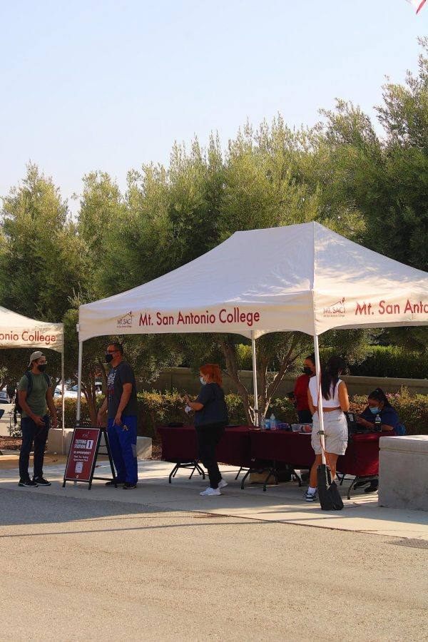 Students administer tests at the testing site near the administration building on Sept. 8.
