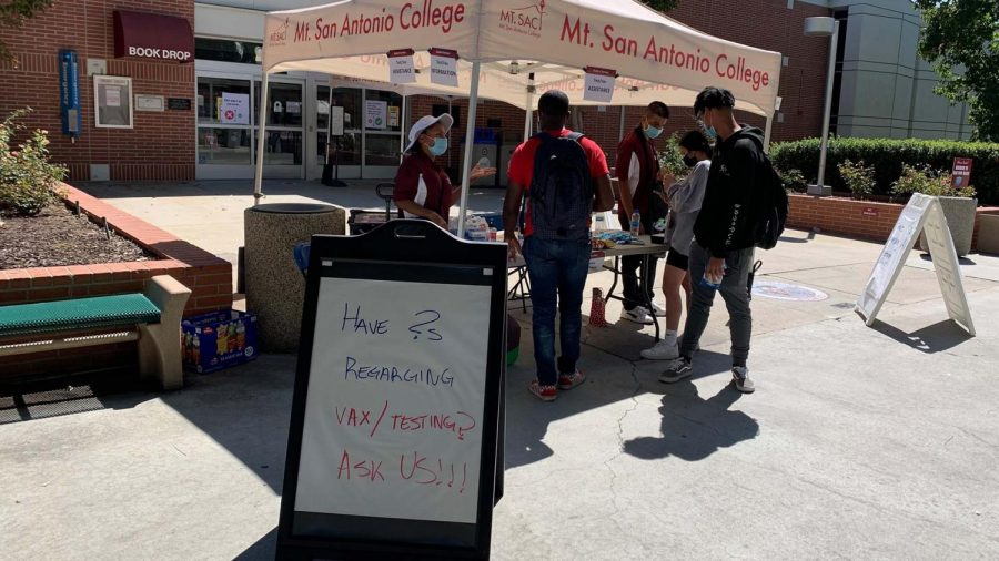 Students ask questions at an information booth outside the Mt. SAC library on Sept. 21.