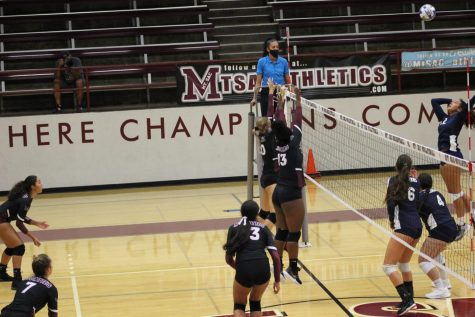 Outside Hitters Raeven Pugh and Riley DeGroot go up to block against El Camino College on Sept. 10.