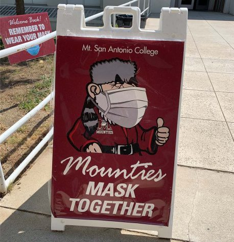Near the rear of the administration building a sign encouraging masking greets students on Sept. 7.