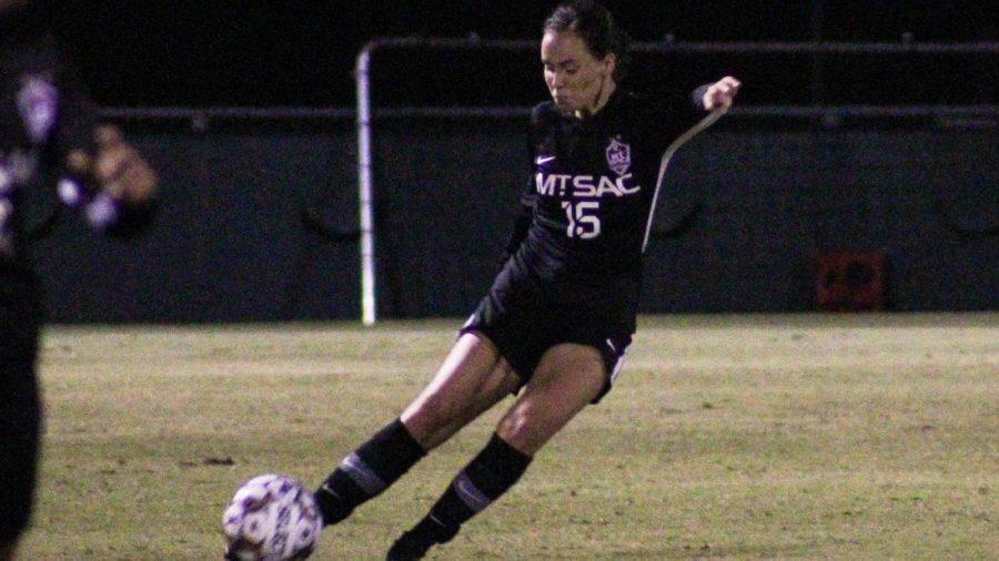 Kayla Allen (15) kicks the ball upfield to assist Karissa Vela (10) in her game winning goal.