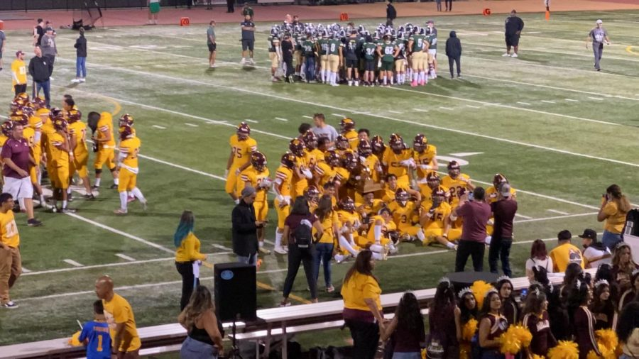 West Covina Bulldogs Celebrating with the trophy after beating South Hills