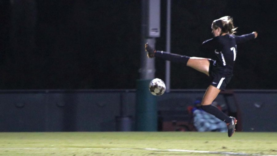 Julia Luceo (14) fields a pass and attempts a midair kick to gain field position.